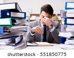 Small photo of Busy businessman under stress due to excessive work