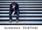 young depressed businessman... | Shutterstock . vector #551873182