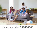 family of four are sitting on... | Shutterstock . vector #551884846