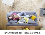 young woman is lying on the... | Shutterstock . vector #551884966