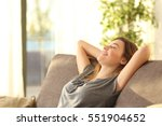 portrait of a girl relaxing on... | Shutterstock . vector #551904652