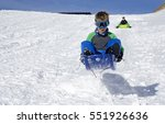 cute young boy jumping on a... | Shutterstock . vector #551926636