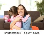 happy mother embracing to her... | Shutterstock . vector #551945326