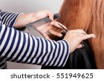 hairdresser cuts  brown haired... | Shutterstock . vector #551949625