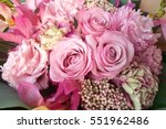 Stock photo pink roses in flower arrangement 551962486