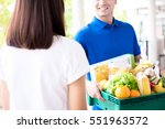 delivery man delivering food to ... | Shutterstock . vector #551963572