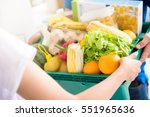 delivery man delivering food to ... | Shutterstock . vector #551965636