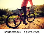 young woman riding mountain... | Shutterstock . vector #551966926