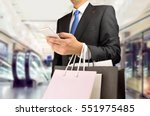 cropped shot of shopper man... | Shutterstock . vector #551975485
