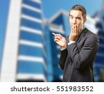 surprised businessman pointing | Shutterstock . vector #551983552
