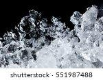 Crushed ice pattern on black background. close up