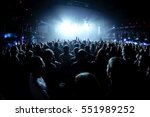 silhouettes of concert crowd in ... | Shutterstock . vector #551989252