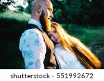 rustic wedding couple on the... | Shutterstock . vector #551992672