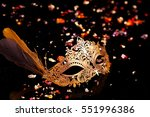 gold carnival mask on black... | Shutterstock . vector #551996386