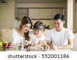 family saving money putting... | Shutterstock . vector #552001186