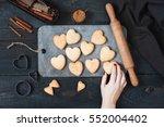 female hand holding the baked... | Shutterstock . vector #552004402