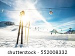 Panoramic view of ski resort glacier and chair lift in french alps - Vacation and travel concept - Winter high season opening with people having fun on mountain - Focus on sport equipment - stock photo