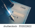 Writing Check Payment Using Elegant Fountain Pen. Executive Desk Business Concept. Corporate Paycheck. - stock photo