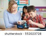 teacher with pupils in science... | Shutterstock . vector #552023728