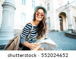attractive tourist girl with... | Shutterstock . vector #552024652
