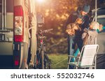 family with dog on a campground ... | Shutterstock . vector #552032746