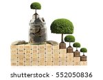 trees growing on coins money on ... | Shutterstock . vector #552050836
