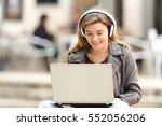 casual girl listening music... | Shutterstock . vector #552056206