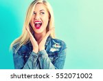 Surprised Young Woman Posing O...
