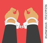 Handcuffs On The Hands Of The...