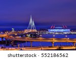 Saint-Petersburg, Russia - December 28, 2016: Cable-stayed bridge across the Petrovsky fairway at the mouth of the Little Neva and football stadium Zenit Arena with night illumination. - stock photo