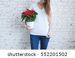 young pretty girl holding...   Shutterstock . vector #552201502