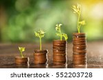 coins stack growing graph with... | Shutterstock . vector #552203728