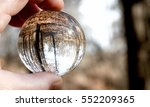 Closeup Of A Glass Ball Held U...