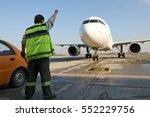 airport marshaller meets the... | Shutterstock . vector #552229756