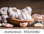 garlic cloves and bulb in... | Shutterstock . vector #552242482