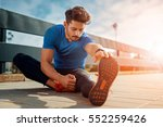 young male jogger athlete... | Shutterstock . vector #552259426