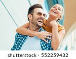 happy couple in love having fun ... | Shutterstock . vector #552259432