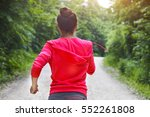 Young Lady Running On A Rural...