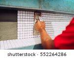 construction worker installing... | Shutterstock . vector #552264286