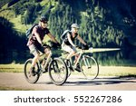 cycling seniors by the lake | Shutterstock . vector #552267286