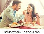 happy couple enjoying food in... | Shutterstock . vector #552281266