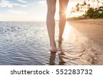 woman walking on a tropical... | Shutterstock . vector #552283732