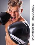 portrait of handsome muscular... | Shutterstock . vector #552300532