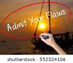 Small photo of Woman Hand Writing Admit Your Flaws with a marker over transparent board. Isolated on Sunset Boat. Business concept. Stock Photo