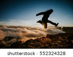 Man Jumping Above Clouds ...