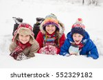three kids lying down together... | Shutterstock . vector #552329182