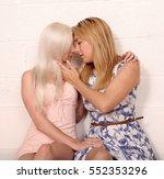 a pair of blonde same sex... | Shutterstock . vector #552353296