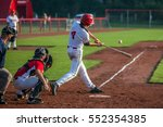 Baseball batter hits the ball