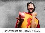 crazy super hero with piggy bank | Shutterstock . vector #552374122