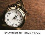 vintage pocket watch on wooden... | Shutterstock . vector #552374722